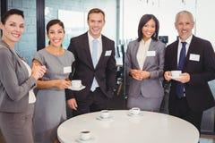 Portrait of businesspeople having tea during breaktime Stock Photo