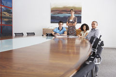 Portrait Of Businesspeople In Meeting At Conference Table Royalty Free Stock Photo
