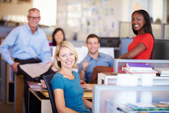 Portrait Of Businesspeople In Modern Open Plan Office. Smiling To Camera Stock Photos