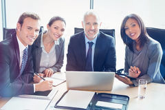 Portrait of businesspeople smiling in conference room. At office royalty free stock photos