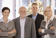 Portrait of businessteam. Portrait of smiling businessteam standing in office Royalty Free Stock Images