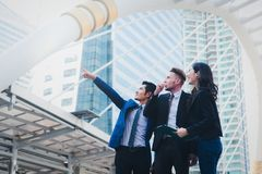Portrait of businessteam pointing up the future on blurred city. Background. Business success concept Stock Images