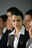 Portrait of a businesswoman. Within a group in the office Stock Image