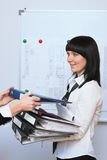 Portrait of  businesswoman. Portrait of young businesswoman with  folder Stock Photography