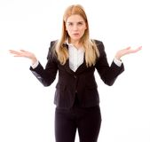 Portrait of a businesswoman arms out asking what's the problem Stock Photo