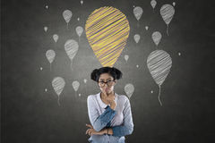Portrait of businesswoman with balloon icons stock images