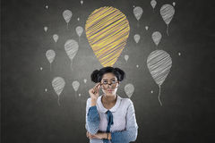 Portrait of businesswoman with balloon icons royalty free stock images