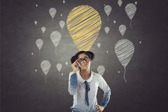 Portrait of businesswoman with balloon icons royalty free stock photo