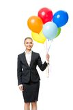 Portrait of businesswoman with balloons Stock Images