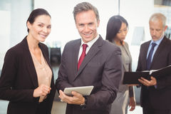 Portrait of businesswoman and businessman with digital tablet Royalty Free Stock Photo
