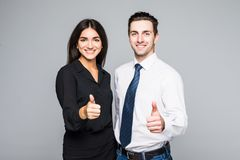 A portrait of a businesswoman and a businessman standing and showing ok isolated on grey Stock Photography