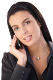 Portrait of businesswoman on call Stock Images