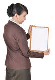 Portrait of businesswoman carrying blank folder Royalty Free Stock Photography