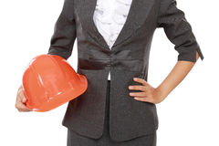Portrait of businesswoman carrying construction helmet Royalty Free Stock Images