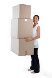 Portrait of businesswoman carrying stack of cardboard boxes Stock Photos