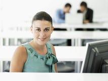 Portrait Of Businesswoman At Computer Desk Stock Photo