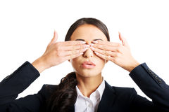 Portrait of businesswoman covering eyes with hands Royalty Free Stock Photo