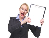Portrait of a businesswoman with crazy expression showing blank sign clipboard Royalty Free Stock Photos