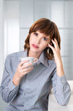 A businesswoman drinking coffee at office Royalty Free Stock Image