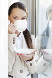 Portrait of businesswoman drinking coffee in office Stock Photos