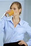 Portrait of businesswoman drinking glass of coffee Stock Image