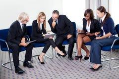 Portrait of businesswoman explaining work Royalty Free Stock Images