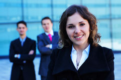 Portrait of a businesswoman in front of her team Stock Image