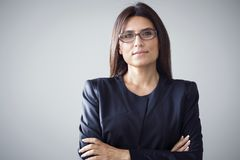 Portrait of businesswoman on grey background Stock Photography