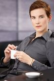 Portrait of businesswoman having coffee Stock Photography