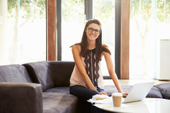Portrait Of Businesswoman Having Working Lunch In Office Stock Photography