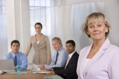 Portrait of businesswoman and her colleagues.. Royalty Free Stock Images