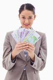 Portrait of a businesswoman holding bank notes Royalty Free Stock Photos