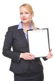 Portrait of a businesswoman holding blank sign clipboard Royalty Free Stock Images