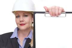 Portrait of a businesswoman holding clipboard with blank paper Stock Photo