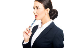 Portrait of businesswoman holding pen under chin Royalty Free Stock Photos