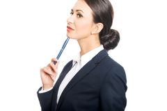 Portrait of businesswoman holding pen under chin Stock Images