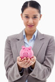 Portrait of a businesswoman holding a piggy bank Royalty Free Stock Photo