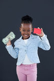 Portrait of businesswoman holding red card and paper currency Royalty Free Stock Photo
