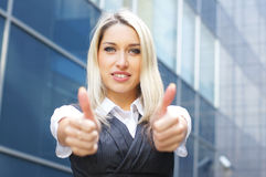 Portrait of a businesswoman holding thumbs up Stock Image