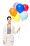 Portrait of businesswoman keeping colorful balloons Royalty Free Stock Photography