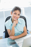 Portrait of businesswoman with laptop at office Royalty Free Stock Image