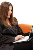Portrait of businesswoman with laptop in orange Royalty Free Stock Image