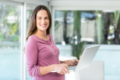 Portrait of businesswoman with laptop Stock Photography