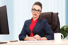 Portrait of businesswoman with laptop writes on a document at he Royalty Free Stock Photos