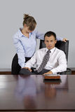 Portrait of businesswoman looking at businessman, sitting in office Stock Photography