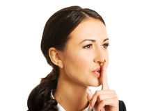 Portrait of businesswoman making silent sign Royalty Free Stock Image