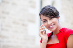 Portrait of businesswoman with mobile phone. Portrait of beautiful business woman in red dress holding her mobile Stock Photography