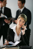 Portrait of a businesswoman in the office. Talking on the phone Stock Photography