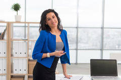 Portrait of businesswoman in office looking confident and smiling. stock photos