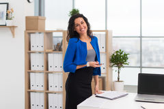 Portrait of businesswoman in office looking confident and smiling. stock images